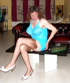 Mature TGirl wearing glasses and a gorgeous teal dress