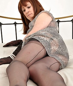 This sexy TGirl is dressed in a gorgeous grey outfit and she is fluttering those bedroom eyes of hers.