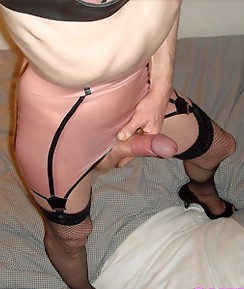 Crossdressing sluts showing off their big cocks and sexy sets of lingerie and panties.