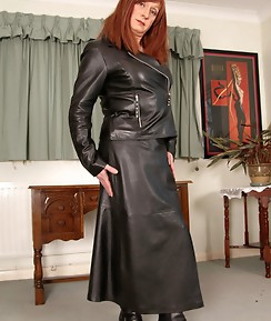 Lucimay slips out of her long leather coat and plays with her hard cock.