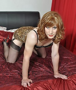 Hot TGirl wearing leopard print shows off her long legs,