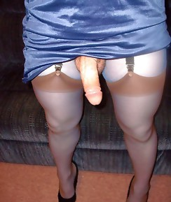 A sexy blue dress with matching nylons gets this horny pantie lover in the mood for some action