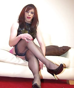 This sexy crossdresser is wearing the perfect combination, a slutty pink PVC mini skirt with a pair of seductive silky nylons