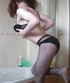 Kinky Pantie boy with long red hair teasing his tight ass and pantyhose in the bathroom