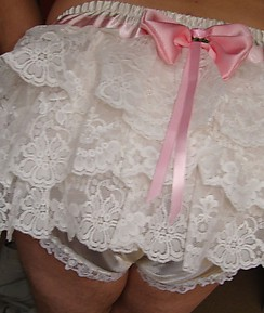 This pantie sluts hard cock looks great in these see through pink bow knickers