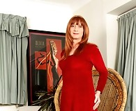 Lucimay wearing a long velvet dress and stroking her cock