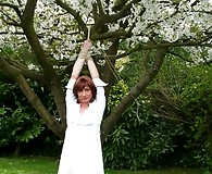 Lucimay has her hands tied to a tree and her knickers pulled down