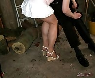 Masked man kidnaps Lucimay and spanks her in the garden shed