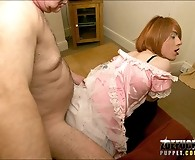 Zoe dressed as a maid sucks her guests cock